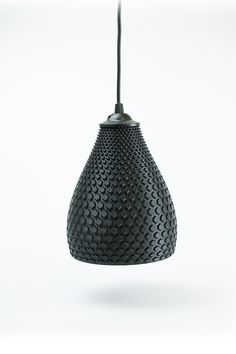 Textured pendant light. #textures #fabrics #moodboard wood, metal, textures inpirations. See more at http://www.brabbu.com/en/inspiration-and-ideas/category/materials