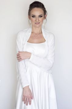 A personal favorite from my Etsy shop https://www.etsy.com/il-en/listing/526179365/wedding-cover-up-white-bridal-bolero