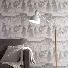 Welcome to this week's choice for Wallpaper Wednesday. It also happens to be National Wallpaper Week. This is a stylish Mirage Grey wallpaper from Graham & Brown that will turn your room into an enchanted forest just waiting to be explored.