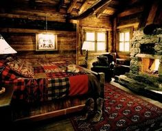 A cozy cabin bedroom with a roaring fire.