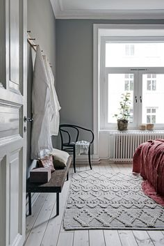 Cozy bedroom with red details - via Coco Lapine Design blog