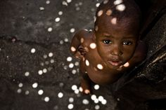 Google Image Result for http://www.jansochor.com/photo-essay/hunger-and-rage/hungry-orphan-baby-haiti.jpg