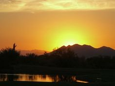 Sunset over the lake on the 10th Hole at Terravita Golf Club in North Scottsdale, Arizona.