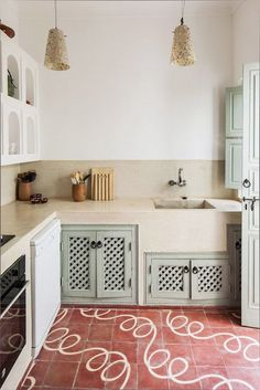 unique red and white floor tiles with mint green cabinets in modern kitchen. Gothic Home Decor, Unique Home Decor, Cheap Home Decor, Home Decor Kitchen, Kitchen Furniture, Home Kitchens, Moroccan Kitchen, Kitchen Cupboard Doors, Cupboard Door Design