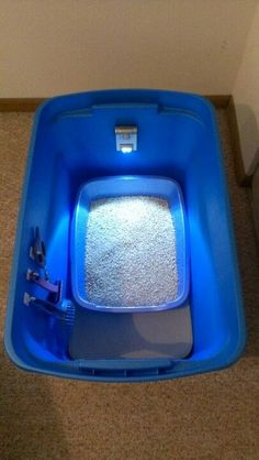 Cat litter box: Get a plastic container and cut a hole in the front. Make sure the box is a little bigger than the litter container itself so that it can trap the litter inside the box. Put a foam mat at the bottom, a few hooks on the side for items such as the scooper and attach a motion light to the back. Thats it! The smell and the litter will stay trapped in the box and you will have everything you need in one spot!: