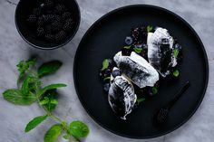Cross over to the dark of the dinner table and get on board with the black food trend that's taking social media by storm. Charcoal Ice Cream, Health Food Shops, Unicorn Foods, Black Food, Fresh Cream, Blueberry, Berries, Sweet Treats, Dishes