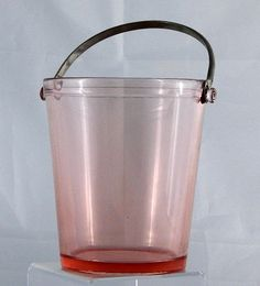 "Ice Bucket Tub Vintage  Depression Pink Glass  Great Condition Large Size    Not sure if this ice bucket come from the ""Roaring Twenties"" but something close.      This vintage 70 to 80 year old ice bucket is a lovely Depression Pink Glass treasure.    This large size ice bucket is made of a beautiful shade of pink glass and comes with the original metal handle.      This ice bucket served faithfully for great-great-grandmother's cocktail parties and is now ready for your 21st Century…"