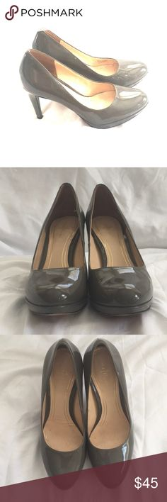 Cole Haan patent leather pumps Gently used Cole Haan patent leather pumps with 3/4 inch platform and 3 inch heels. Perfect for work. Lots of life left in these shoes--I'm selling because my feet grew half a size when I was pregnant! Cole Haan Shoes Heels