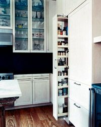 Interior designer #EldonWong uses narrow spaces ingeniously: The custom six-foot-tall pull-out pantry is accessible from both sides.