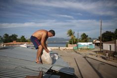 Adolfo Leiva, who is self-employed, puts sandbags over the roof of his home ahead of the arrival of Hurricane Matthew in Santiago de Cuba, Cuba, October 3, 2016. REUTERS/Alexandre Meneghini  via @AOL_Lifestyle Read more: http://www.aol.com/article/news/2016/10/06/hurricane-matthew-closes-in-on-florida-as-haiti-death-toll-rises/21576250/?a_dgi=aolshare_pinterest#fullscreen