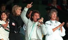 Sir Cliff Richard entertains the crowd at wimbledon during the rain
