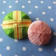 Needle woven buttons