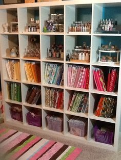 Craft room fabric storage & supplies  hmmm I have this shelf. its covered in books. I like this better.