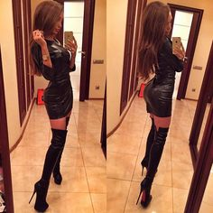 Tall skinny girl in tight leather dress and sexy high knee leather boots.
