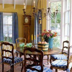 Blue and Yellow dining area with Buffalo plaid chair cushions and draperies... casually elegant for a breakfast area, and so French Country... found at: Eye For Design: Decorate With Blue and White Buffalo Plaid ~ http://eyefordesignlfd.blogspot.com/2015/05/decorate-with-blue-and-white-buffalo.html