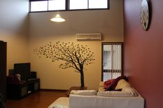 """We love the way our customer Marina used our Tall Leaning Tree Blowing with Blossoms as a focal point in her living room! """"Hi Dali Team, Thank you very much for your service!! We are really very, very, very happy to use your fabulous creations in our house. Thank you 100 times!"""" - Marina, Australia @Dali Wall Decals #dalidecals #walldecals #interiordesign"""