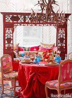 A range of racy red hues bring drama to this intimate table setting.  See more of this vibrant tablescape.   - HouseBeautiful.com