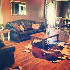 Cowhide rug, rustic, affordable living room.