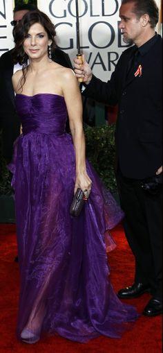 Sandra Bullock wears a purple dress at the Golden Globes 2010