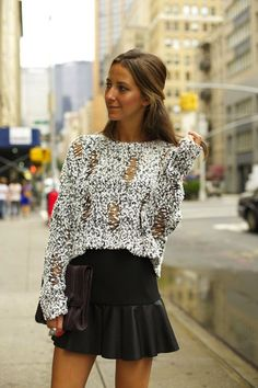 Fluffy sweater, black leather skirt and handbag. Top 10 winter fashion trends.