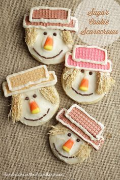 Scarecrow Sugar Cookies, how fun are these fall scarecrow cookies! Kids would have a blast making these treats for a fall party or special dessert. HandmadeintheHeartland.com
