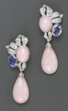 A pair of pink opal, sapphire, diamond and fourteen karat white gold pendant earrings
