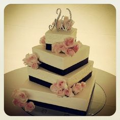 A fun shape for a square wedding cake!  Buttercream frosting with navy ribbon and fresh pink roses. by bluecakecompany, via Flickr