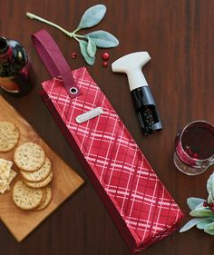 Perfectly Plaid Wine Tote. Give the gift of holiday cheer in a stylish and festive way. Available through December 9, 2016.