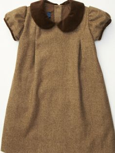 We took our classic Charlotte dress and winterized it in rich tweed, accented with chocolate brown velvet along the sleeves and at the collar. Capped sleeves, peter pan collar, and A-line bodice make this a classic look for every little girl. Fully lined, It slips on easy with three mother-of-pearl button closures on the back. 100% Wool with Cotton LiningMade in the USADry Clean Only
