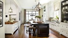 Traditional Kitchen, turned legs on the island, white cabinets to the ceiling, wood floors, butcher block work island...