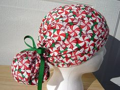 $13.99 This scrub hat has GREAT RED and WHITE STRIPED CANDY PEPPERMINTS all over it on a CHRISTMAS GREEN BACKGROUND. It  is tied with a FUN...