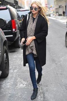 Gigi Hadid hit a fashion high note with her grey fur coat and mirrored sunglasses as she walked through New York on Feabruary 14, 2015. She teamed her thick coat with a pair of tight blue jeans and kept it comfortable with black ankle boots.