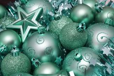 Love this image: Festive seasonal background with a variety of turquoise green Christmas baubles and ornaments - By stockarch.com user: christmasman