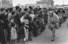 CHINA. Jiangsu. Nankin. April 1949. As the first soldiers of the People's Liberation Army arrive in Nanking, its citizens regard them with impassive curiosity and caution. The armies...