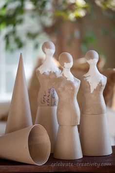 """Great idea for DIY tree topper: """"dress form"""", cone, and head (use masking tape if need be)."""