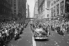 New Yorkers line 42nd Street to cheer Apollo 11 astronauts on August 13, 1969. In lead car from left are: Edwin Aldrin, Michael Collins and Neil Armstrong, who return the greeting with waves. Motorcade is traveling East on 42nd street, towards the United Nations building. (AP Photo/STF)
