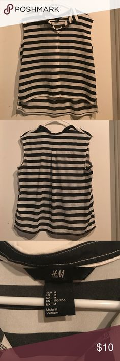 Boxy stripped blouse Half my closet is stripes lol. Things that don't fit have to go. Cute for work or play. Only wore once. I think it runs large. Fit me when I was a large. H&M Tops Blouses