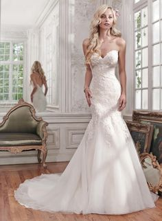 MAGGIE BRIDAL BY MAGGIE SOTTERO MIRANDA-6MS267:Gorgeous lace and tulle combine to create this stunning fit and flare wedding dress, accented with shimmering beads and a classic sweetheart neckline. Finished with covered buttons over zipper and inner elastic closure.
