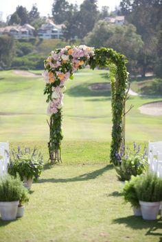 Ceremony arch and potted aisle markers // Arch:  The Vine's Leaf // John & Joseph Photography // http://www.theknot.com/submit-your-wedding/photo/3700f3d1-ef04-46e7-9441-636c83e27edf/Joanne-and-Juns-Garden-Wedding