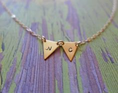 hand stamped gold pennant necklace by juliethefish on Etsy