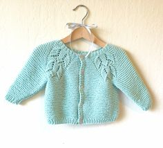 """Knit pattern for a feminine baby cardigan in garter st with a lovely lace """"flower raglan""""."""