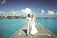 The beautiful Natalya celebrating her wedding in Bora Bora! Natalya is wearing the Katie May Poipu Bridal Gown. http://www.katiemay.com/products/poipu