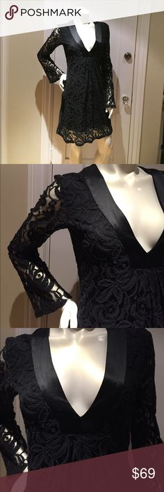 SINGLE DRESS - Black Lace Bell Sleeved Dress This little black dress is darling with bell sleeves and satin accents at the neckline.  Very comfortable and have only worn twice. Single Dress Dresses Long Sleeve