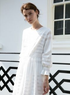 """Young+British+Designers:+Light+of+Heart+White+Cotton+Dress+by+Kelly+Love+-+""""She+had+a+sweet+face,+a+wild+laugh+and+a+crazy+mind.+I+could+have+spent+every+waking+minute+with+her.""""+ Each+new+collection+by+Kelly+Love+is+based+upon+a+hugely+evocative+story.+This+'Light+of+Heart'+dress+was+designed+to+be+worn+by+a+young,+free+soul+(of+any+age)+intent+upon+painting+herself+an+unforgettable+life."""