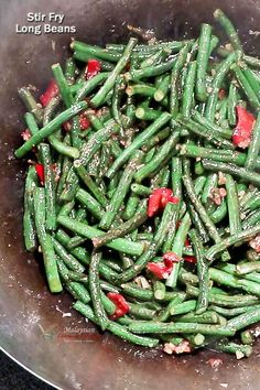 Crunchy and tasty Stir Fry Long Beans flavored with garlic, ginger, chilies, and fermented soy beans. Delicious served with steamed rice or congee. | MalaysianChineseKitchen.com