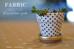 Adorable Fabric Pots, this is so simple!  Why haven't I thought of it yet.