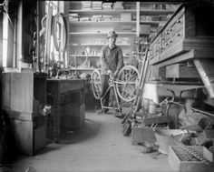 """Bicycle Repair Shop. Man repairing a bicycle in a shop, probably the Repair Shop of Leslie Werner. Man identified as probably Leslie Werner,"" Black River Falls, Wisconsin. (Wisconsin Historical Society, Image ID: WHi-42213.)"