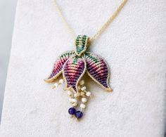 Macramé flower necklace with amethyst beads. Artistic by EleguaArt