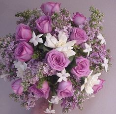 Gardenia and ourple lilacs Wedding Flowers  | Wedding Flowers Photos.      Gardenias, stephenotus, lilacs and purple roses!    Everything Wonderful in my opinion !   AL