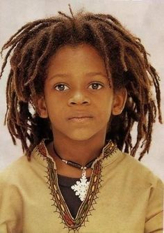Handsome young brotha with locs, rockin the garb.